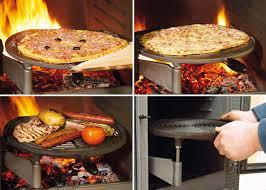 poele à bois pour cuisiner cuisine feu de bois cuisson avec les plateaux culinaires oliger