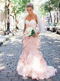 wearing a blush wedding dress on your great day styleskier com