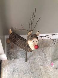 log reindeer log reindeer styling christmas decor snowman and