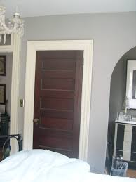 love the white trim with dark stained doors i want to paint my