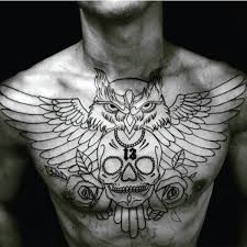 collection of 25 skull with black wings tattoos on chest