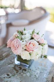 White Roses Centerpiece by How To Pick The Perfect Wedding Florist Blush Pink Compact And