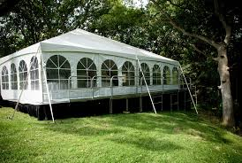 level tent on stage for backyard wedding with stepped walkway