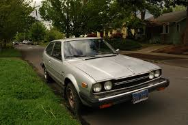 hatchback cars 1980s old parked cars 2 silver beans on 1 block 1980 honda accord