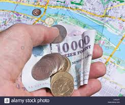 Map Of Budapest Mans Hand Holding Hungarian Forint Money Over Map Of Budapest