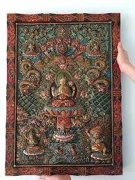 nepal buddhism wood carving painting four arms kwan yin buddha