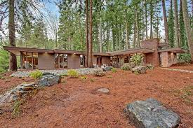 frank lloyd wright inspired home with lush landscaping renovated frank lloyd wright inspired home around corner from