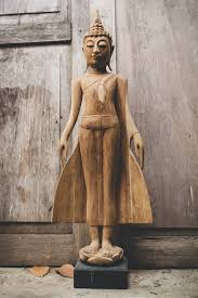 open earth gesture buddha statue on lotus flower siam sawadee