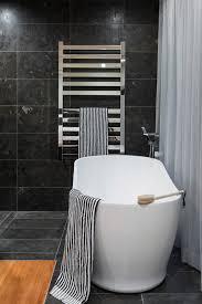 splashy heated towel rack in bathroom contemporary with bathroom