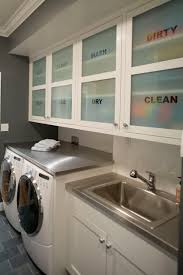 Laundry Room Storage Between Washer And Dryer by 15 Ways To Organize Your Laundry Room