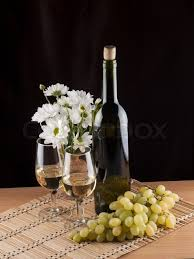 flowers wine bottle glass with wine and flowers stock photo colourbox