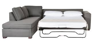 l shaped gray fabric sleeper sofa plus cushions connected with