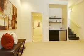 relaxing basement layout with kitchenette and new carpet homeyou