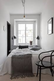 white ceiling with chandelier white wooden bed with rack storage