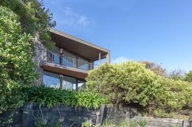 house built on top of a sand dune to take in the best view
