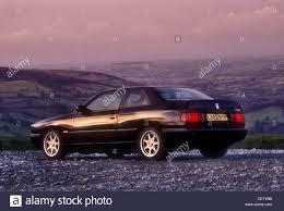 purple maserati maserati ghibli 1994 driving on in the black mountains wales uk