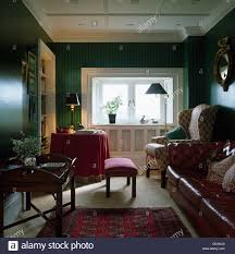 Reddish Brown Leather Sofa Wing Chair And Brown Leather Sofa In Green Living Room With