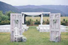 wedding arch using doors doors set up to give the illusion of going through church