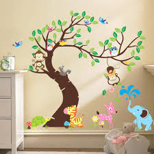 baby room jungle wall decals brightly colored tree and jungle