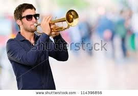 holding trumpet outdoor stock photo 128015846