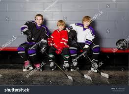 three youth boys hockey players pose stock photo 126481292
