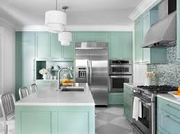 sage green kitchen cabinet with modern pendant lighting for