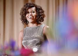 ms obamas hair new cut michelle obama unveils curly hair at white house correspondents