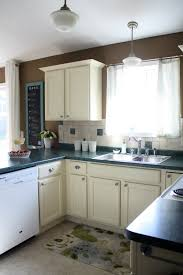 How To Paint Old Kitchen Cabinets Iheart Organizing Finally How To Paint Cabinets U0026 Trim