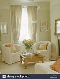 White Cotton Curtains White Loose Covers On Tub Chairs In Front Of Window With Pale Gray