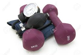 stethoscope and dumbbell training weights together to