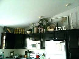 Decorating Ideas For The Top Of Kitchen Cabinets Pictures Kitchen Cabinet Top Decor Bloomingcactus Me