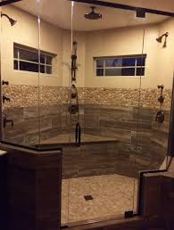 finished shower remodel faux wood plank tile river rock floor