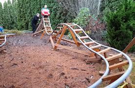 roller coaster for backyard grandpa builds 3 exciting roller coasters in his backyard for his