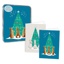 eight christmas cards in a tin two designs depicting rabbits