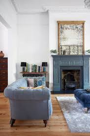 blue and white family room house beautiful pinterest livingroom coastal decor is found in the details this spacious