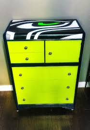 old waterfall dresser updated into a fabulous seahawks dresser