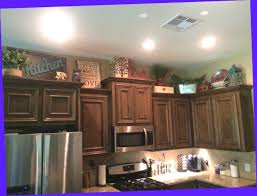 how to decorate top of kitchen cabinets fill in space above kitchen cabinets above kitchen cabinet