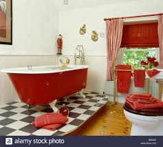 Vinyl Floor In Bathroom Red Rolltop Bath On Raised Black White Vinyl Floor In Bathroom