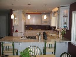white kitchen cabinets dark wood trim dark paint white trim