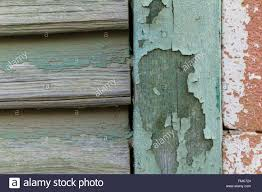 cyan peeling paint window wood planks and pink brick wall shot
