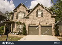 nice brick house two car garage stock photo 12952588 shutterstock