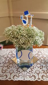 simple centerpiece made by elegant times bows or baseball theme