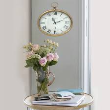 stratton home decor gold oval wall clock s02199 the home depot