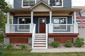 exterior brown wooden porch with white wooden railing also wooden