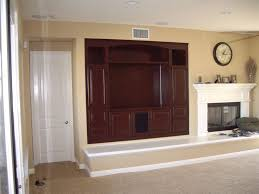 cabinets built into wall niche by fireplace cabinet wholesalers