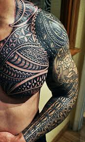 see more black tribal on arms and chest tattoos
