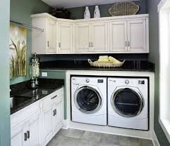 laundry room with black countertops and white cabinets choosing
