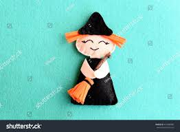 kids halloween background images halloween witch doll isolated on blue stock photo 470390996