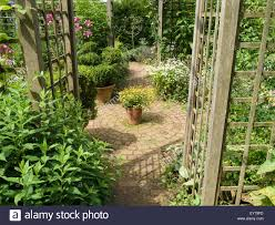 cottage garden with plants trellis brick paver paths and patio