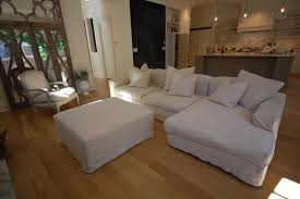 Living Room Ottoman by Decorating Couch Cheap Slipcovers With Wooden Floor And Ottoman